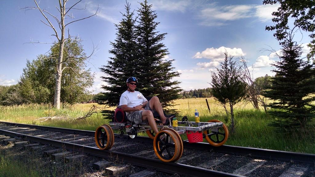 Kim Metlen demonstrates pedaling a Railrider.